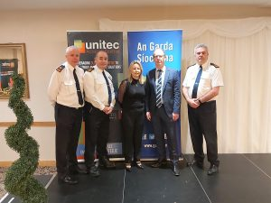 Michelle, from the Unitec team, with members of the Gardaí at the Fraud & Cyber Crime Prevention Seminar in February 2020