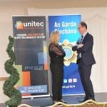 Michelle, from the Unitec team, chats with a member of Clonmel's Garda at the Garda Fraud & Cyber Crime Prevention Seminar in February 2020